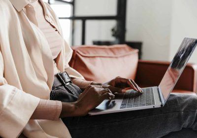 Cropped image of woman working with laptop computer